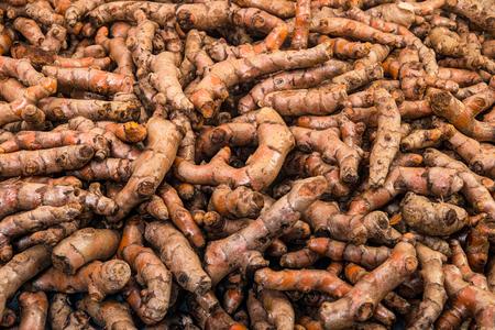 Full basket of turmeric is on display for sale in the fresh vegetable market Zdjęcie Seryjne