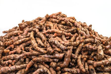 Fresh turmeric roots display in the fresh vegetable market