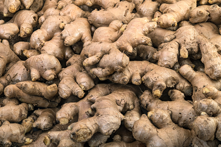 Fresh ginger roots display on sale in the fresh vegetable market
