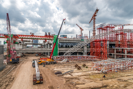 Cranes Working on Expressway Construction Sites in Asia