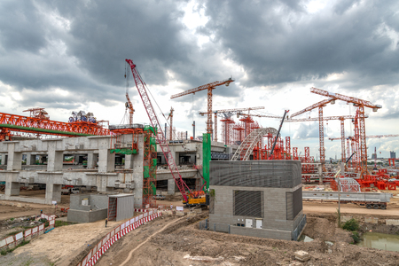 Construction Cranes Working on Expressway and Skytrain Site in Asia