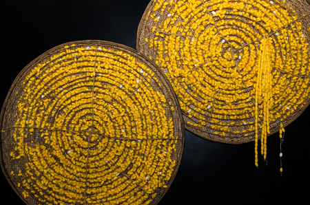 Yellow silkworm cocoon in basket from bamboo Banque d'images