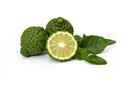 Bergamot fruit kaffir limes and green leaves for herbal products on a white background Stock Photo