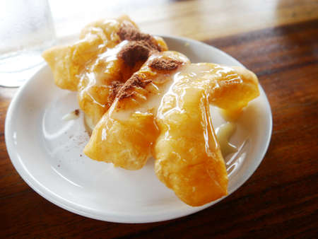 patongkoh: deep fried dough stick with condensed milk and chocolate powder, breakfast