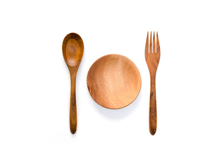 dish disk: Top view of empty wooden dish, wooden fork and wooden spoon on white background. Stock Photo