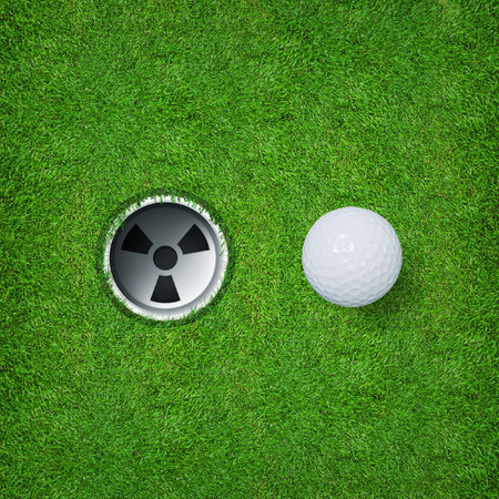 par: White golf ball and golf hole on green grass of golf course.