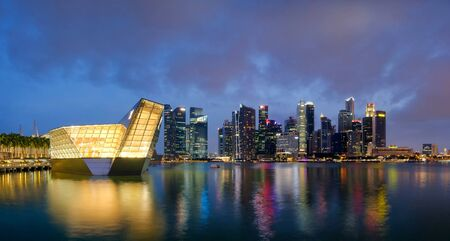The futuristic building of Louis Vuitton shop in Marina Bay with Singapore city background.
