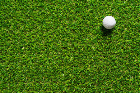 Golf ball on green grass texture of golf course for sport idea background. 写真素材
