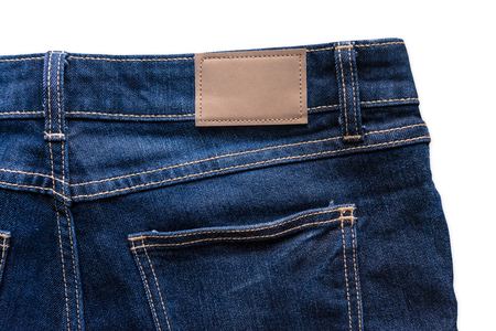 Back of blue jeans with leather jeans label sewed on a blue jeans. Isolated on white background with clipping path. Stockfoto