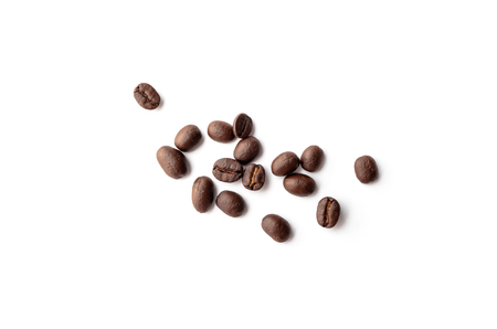 Roasted coffee beans on white background. Close-up image. 写真素材
