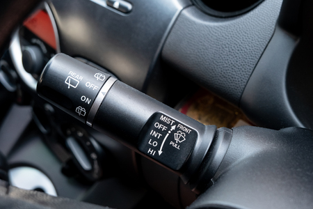Car wipers control buttons. Adjustable wiper blade inside driver place.