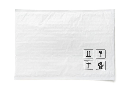 White postal package. Plastic parcel with fragile care sign and symbol. Object isolated on white background with clipping path.