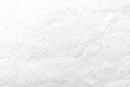 Paper texture. White crumpled paper background. Close-up image.