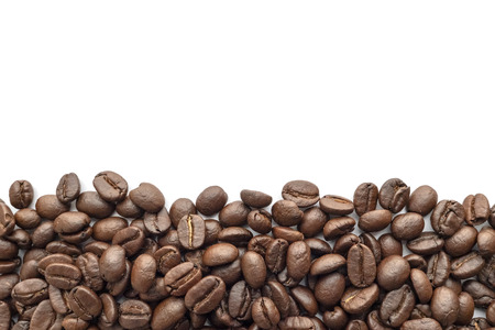 Roasted coffee beans on white background. Close-up image. Reklamní fotografie