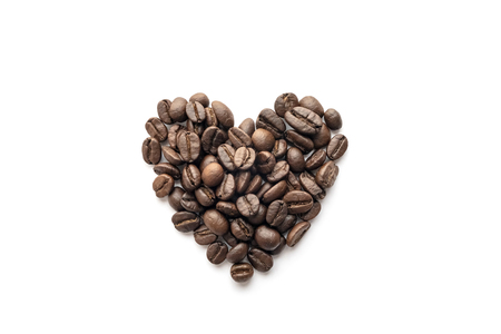 Heart shape of roasted coffee beans isolated on white background.