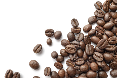 Roasted coffee beans isolated on white background. Close-up image.