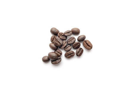 Roasted coffee beans isolated on white background. Close-up image. Фото со стока