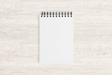 Top view for business background. Blank notebook for painting, drawing and sketching on wooden texture background.