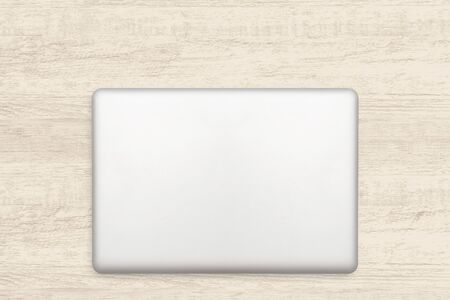 Laptop computer on white wooden texture background.