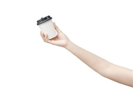 Take away coffee cup background. Female hand holding a coffee paper cup isolated on white background Reklamní fotografie - 134728630