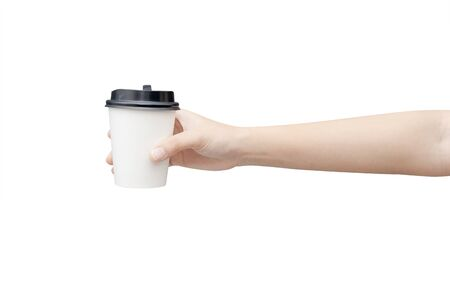 Take away coffee cup background. Female hand holding a coffee paper cup isolated on white background Reklamní fotografie - 134728992
