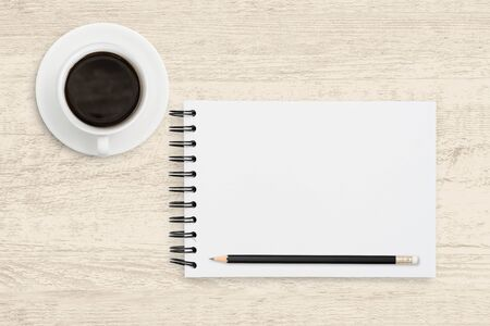 Top view business background of white paper sheet of notebook with coffee cup on wooden texture background. Reklamní fotografie - 134729033