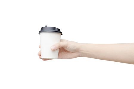 Take away coffee cup background. Female hand holding a coffee paper cup isolated on white background Reklamní fotografie - 134729036