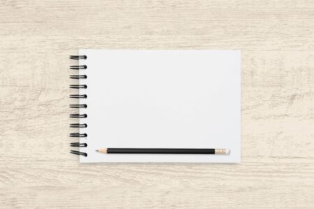 Top view object background of blank notebook and pencil on wooden texture background. Reklamní fotografie - 134729377