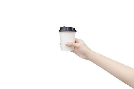 Take away coffee cup background. Female hand holding a coffee paper cup isolated on white background Reklamní fotografie - 134729382