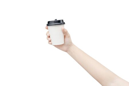 Take away coffee cup background. Female hand holding a coffee paper cup isolated on white background Reklamní fotografie - 134729395