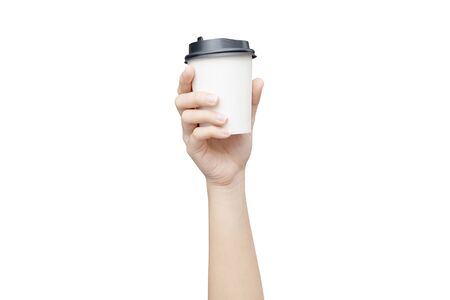 Take away coffee cup background. Female hand holding a coffee paper cup isolated on white background Reklamní fotografie - 134729627