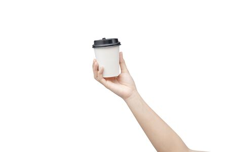 Take away coffee cup background. Female hand holding a coffee paper cup isolated on white background Reklamní fotografie - 134729658