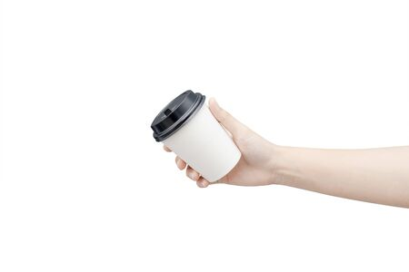 Take away coffee cup background. Female hand holding a coffee paper cup isolated on white background Reklamní fotografie - 134729763