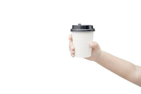 Take away coffee cup background. Female hand holding a coffee paper cup isolated on white background