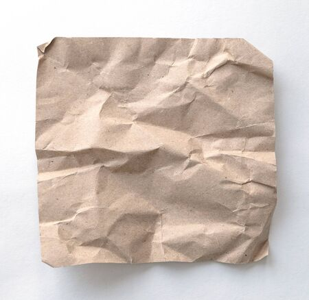 Brown wrinkle recycle paper background. Crumpled brown paper on white background, can use text banners products or business cards.