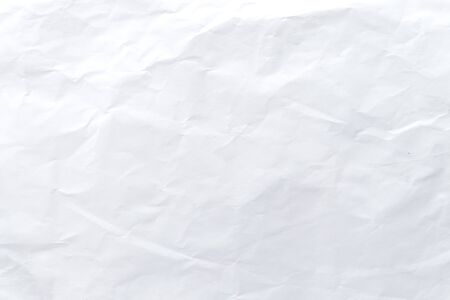 White crumpled paper pattern and texture for background. White creased paper background. Close up.