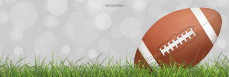 American football ball on green grass field with light blurred bokeh background. Vector illustration. Foto de archivo - 155875891