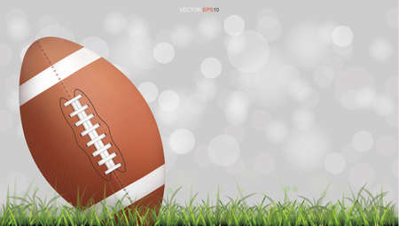 American football ball or rugby football ball on green grass court with light blurred bokeh background. Vector illustration. Foto de archivo - 155875982