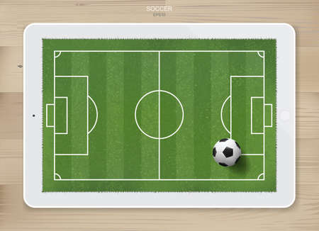 Soccer football ball in soccer field area on tablet display with wood texture background. For create soccer game and soccer football tactic idea. Vector illustration.