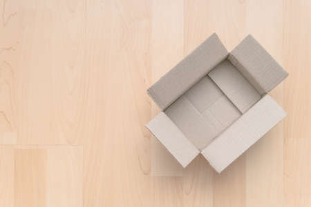 Empty open rectangular cardboard box on wood. Shopping online object background. Shipping parcel object.