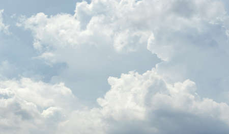 Beautiful sky with white clouds pattern background. Sky and clouds in daylight. Outdoor natural abstract background.