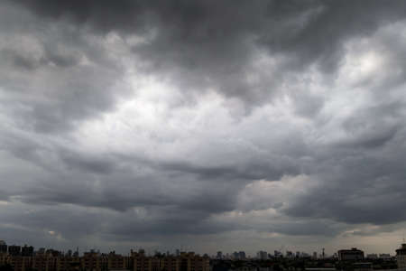Dark storm clouds before rain used for climate background. Clouds become dark gray before raining. Abstract dramatic background.