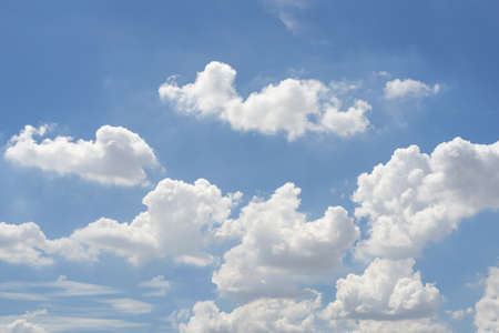 Sky with white clouds pattern background. Sky and clouds in daylight. Outdoor natural abstract background.