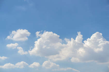 Blue sky with white clouds pattern background. Sky and clouds in daylight. Outdoor natural abstract background.
