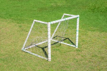 Soccer goal post on green grass field. Soccer football sport for playground.