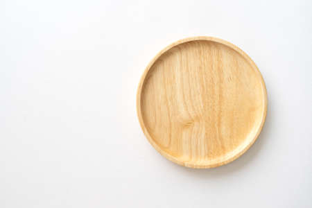 Top view of wooden dish for kitchen background. Close-up image.
