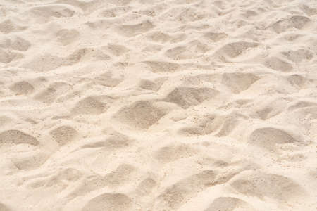 Sand on the beach for background. Brown beach sand texture as background. Close-up. Stockfoto