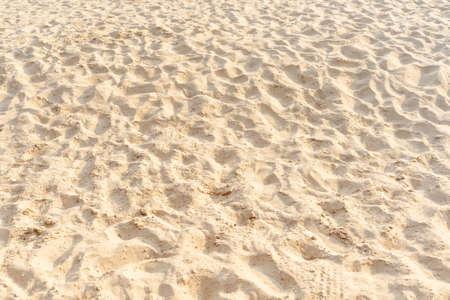 Sand on the beach as background. Light beige sea sand texture pattern, sandy beach texture background. 版權商用圖片