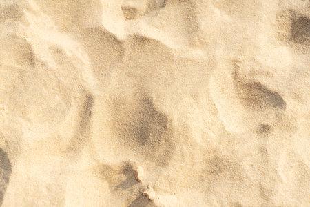 Sand texture background on the beach. Light beige sea sand texture pattern, sandy beach background. 版權商用圖片