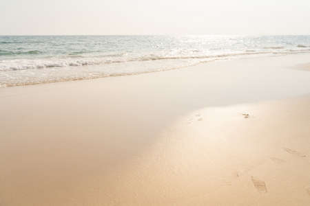 Sea and sand on tropical beach for vacation background.